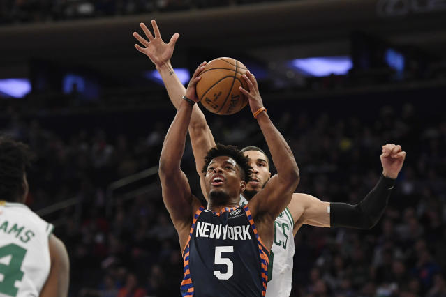 New York Knicks guard Dennis Smith Jr. (5) attempts a basket during the first half of an NBA basketball game against the Boston Celtics, Sunday, Dec. 1, 2019, in New York. (AP Photo/Sarah Stier)