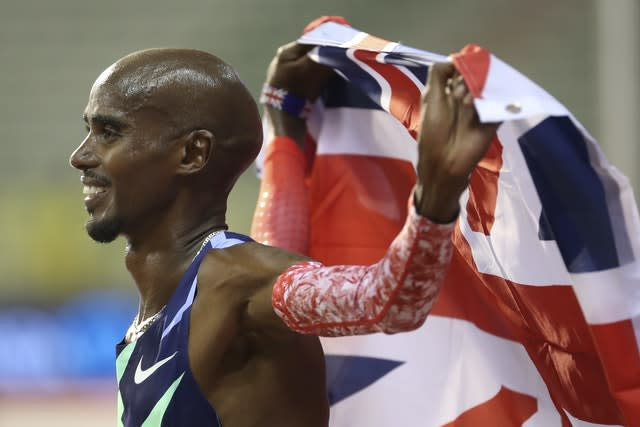 Sir Mo Farah celebrates after winning the men's one hour race and setting a new world record