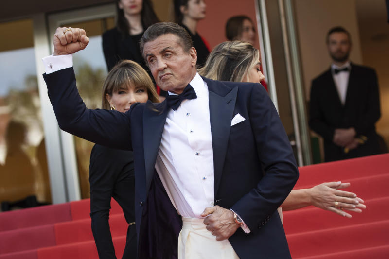 Sylvester Stallone, Sistine Stallone and Jennifer Flavin pose for photographers upon arrival at the awards ceremony of the 72nd international film festival, Cannes, southern France, Saturday, May 25, 2019. (Photo by Vianney Le Caer/Invision/AP)