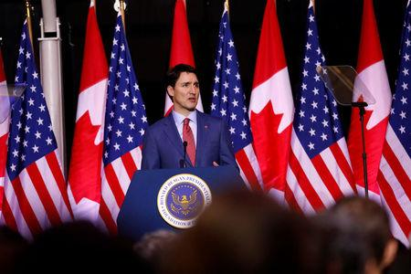 Canadian Prime Minister Justin Trudeau speaks in the Air Force One Pavilion at the Ronald Reagan Presidential Library in Simi Valley