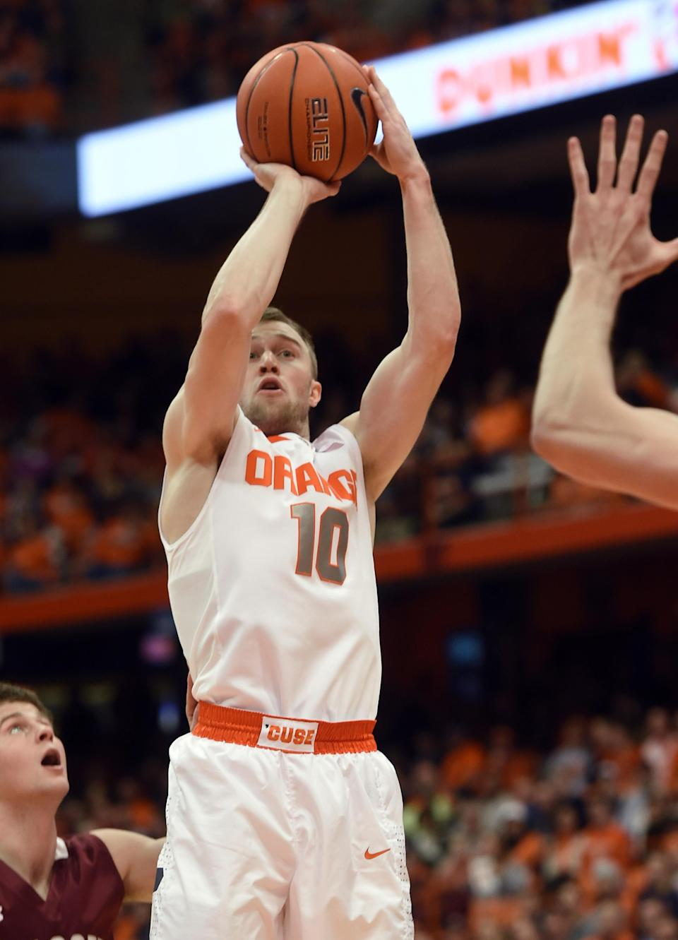 Syracuse's Trevor Cooney shoots against Colgate during the first half of an NCAA college basketball game in Syracuse, N.Y., Monday, Dec. 22, 2014. (AP Photo/Kevin Rivoli)