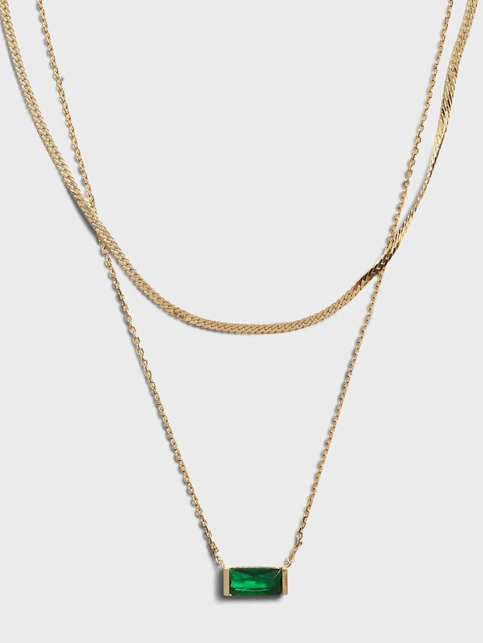 <p>The easiest necklace to wear with any neckline is a longer one and a layered neckline like this <span>Banana Republic Emerald Double Layer Necklace</span> ($48) created a fun playground drawing people up to your beautiful smile!</p>