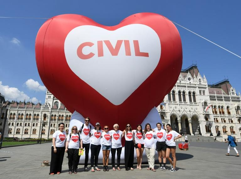 Leading Hungarian NGOs pose with a giant heart-shaped balloon during a demonstration against the so-called 'Stop Soros' laws