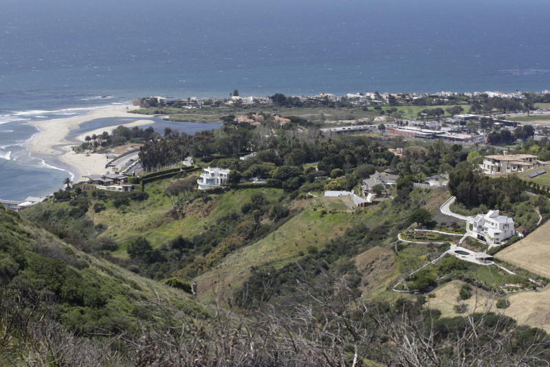 File - In this April 8, 2009, file photo, is an ocean view seen from a hill area adjacent to the proposed Malibu development of U2 guitarist The Edge in Malibu, Calif. A plan by U2 guitarist The Edge to build a cluster of mansions on a ridgeline above Malibu appears dead, after California's highest court declined to consider his last-ditch appeal. The musician, whose real name is David Evans, staged a 14-year legal fight to build five eco-friendly homes dubbed Leaves in the Wind in an undeveloped section of the Santa Monica Mountains west of Los Angeles. The state Supreme Court decided last week not to review a lower court ruling that denied approval to build on the land after the Sierra Club sued to block construction. (AP Photo/Damian Dovarganes, File)