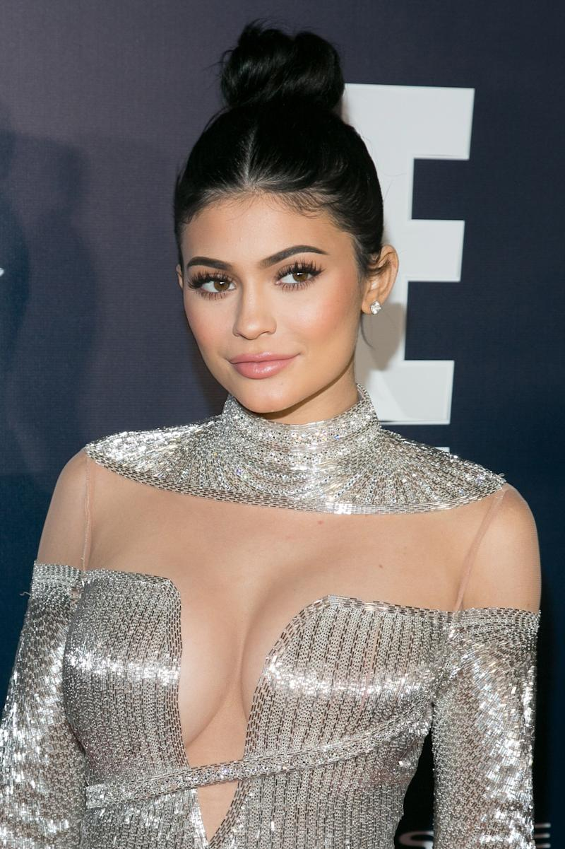 Jenner keeps her look minimal with a simple top knot and a glossy, pink lip at the 74th Annual Golden Globes After Party.