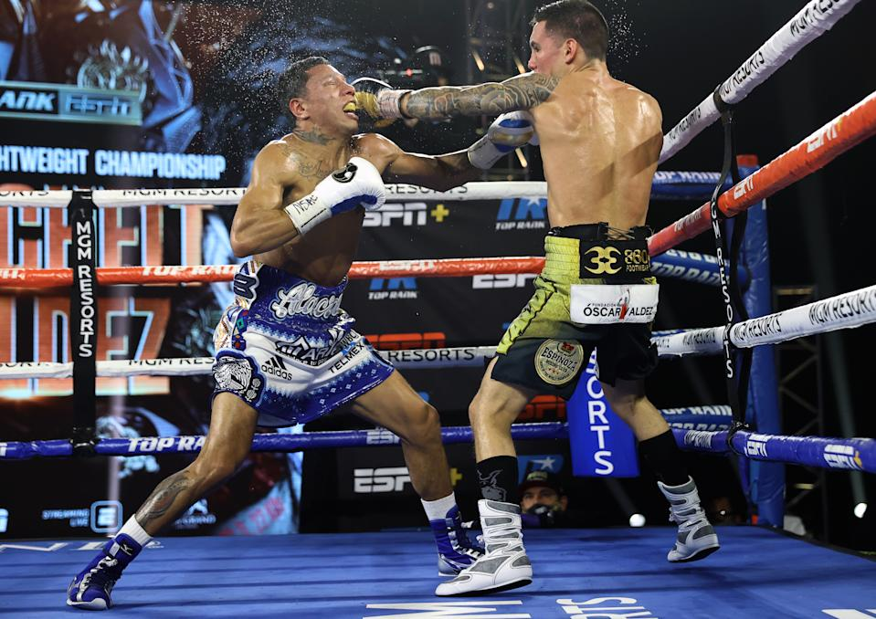 LAS VEGAS, NV - FEBRUARY 20: Miguel Berchelt and Oscar Valdez exchange punches during their fight for the WBC super featherweight title at the MGM Grand Conference Center on February 20, 2021 in Las Vegas, Nevada. (Photo by Mikey Williams/Top Rank Inc via Getty Images)