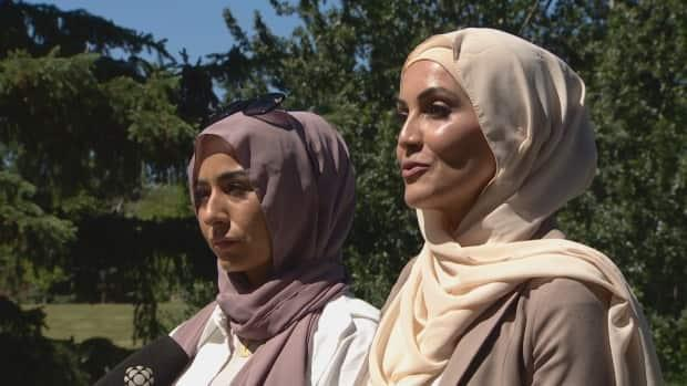Friends Houda Alkasm (left) and Nesrine Merhi-Tarrabain (right) say an attack this week on two sisters wearing hijabs has left them shaken.  (Trevor Wilson/CBC - image credit)