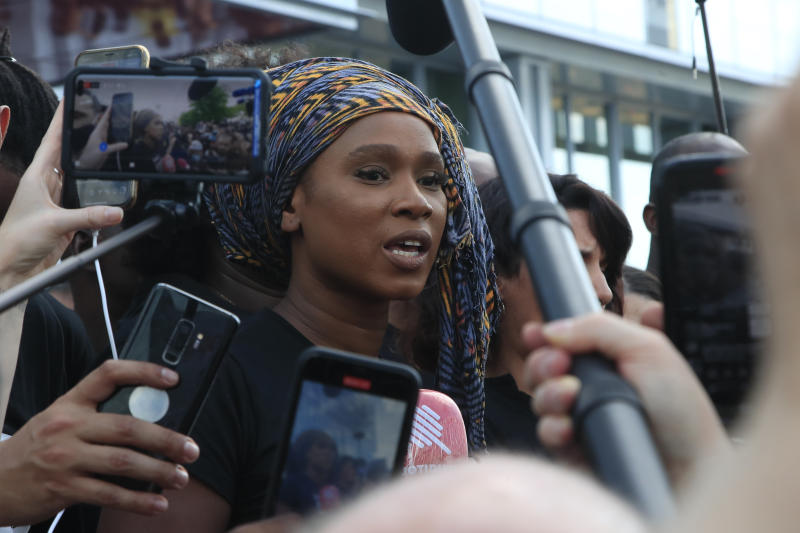 Assa Traore, sister of Adama Traore, answers reporters outside the Palace of Justice Tuesday, June 2, 2020 in Paris. French authorities banned the protest over racial injustice and heavy-handed police tactics as global outrage over what happened to George Floyd in the United States kindled frustrations across borders and continents. Family and friends of Adama Traore, a French black man who died shortly after he was arrested by police in 2016, call for a protest which will also pay homage to George Floyd. (AP Photo/Michel Euler)