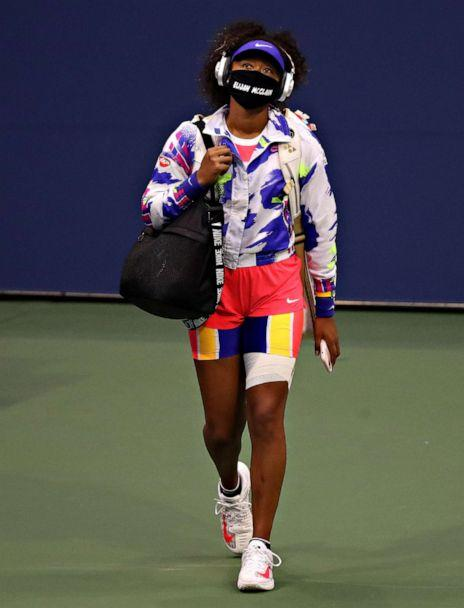 PHOTO: Naomi Osaka walks onto the court wearing a mask bearing Elijah McClain's name before her singles second round match against Camila Giorgi of Italy on Day Three of the US Open, Sept. 2, 2020, in Queens, New York. (Matthew Stockman/Getty Images)