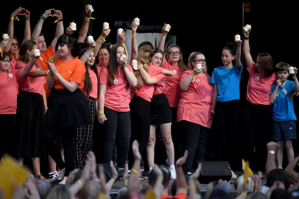 <p>Local choirs performed at the event, which paid tribute to the 22 people killed when Abedi detonated a bomb at an Ariana Grande concert on 22 May 2017 (Picture: Getty) </p>