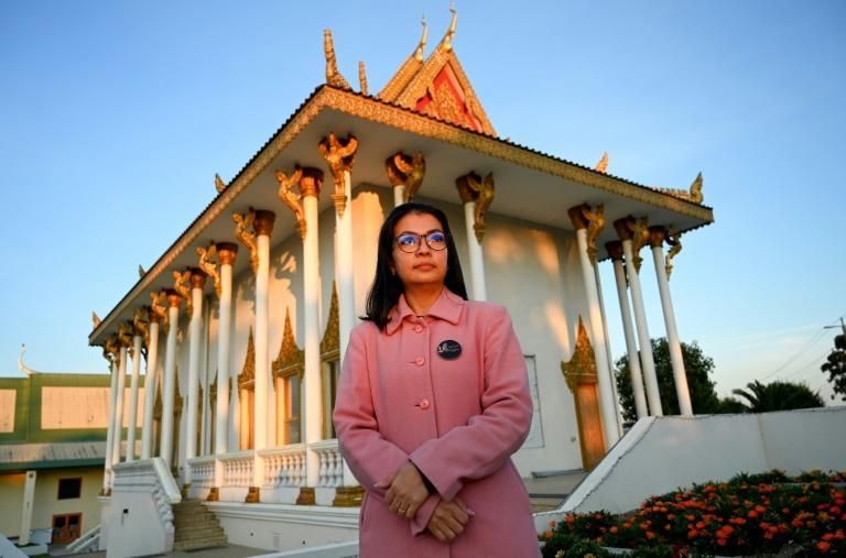 Bou Rachna keeps her husband's activism and memory alive, donating to youth democracy campaigners in Cambodia