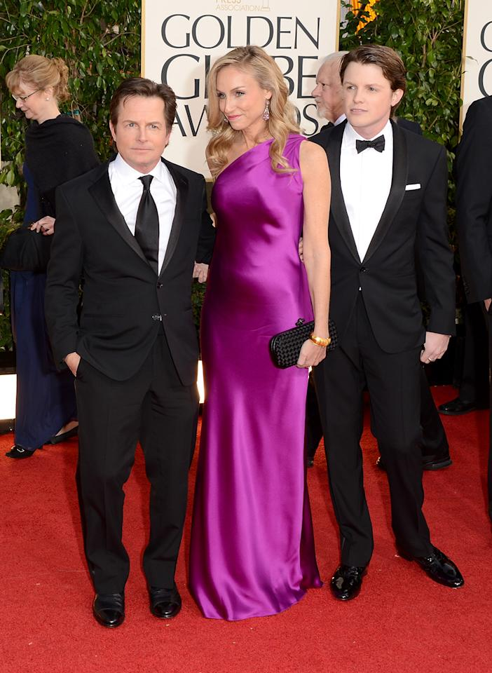 ANUARY 13:  (L-R) Actor Michael J. Fox, actress Tracy Pollan and Mr. Golden Globe Sam Fox arrive at the 70th Annual Golden Globe Awards at the Beverly Hilton in Beverly Hills, CA on January 13, 2013.