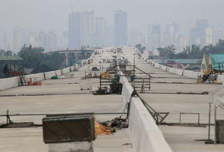 A newly dried concrete and secure linking steel bars of the 5.58 kilometre elevated highway is seen in Caloocan City, metro Manila, Philippines on August 2, 2017. REUTERS/Romeo Ranoco