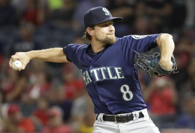Seattle Mariners starting pitcher Mike Leake throws against the Los Angeles Angels during the first inning of a baseball game in Anaheim, Calif., Thursday, Sept. 13, 2018. (AP Photo/Chris Carlson)