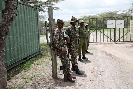 Wildlife rangers guards the enclosure where Sudan, the last male northern white rhino, who died on Monday, was kept in the Ol Pejeta Conservancy in Laikipia National Park, Kenya March 20, 2018. REUTERS/Baz Ratner