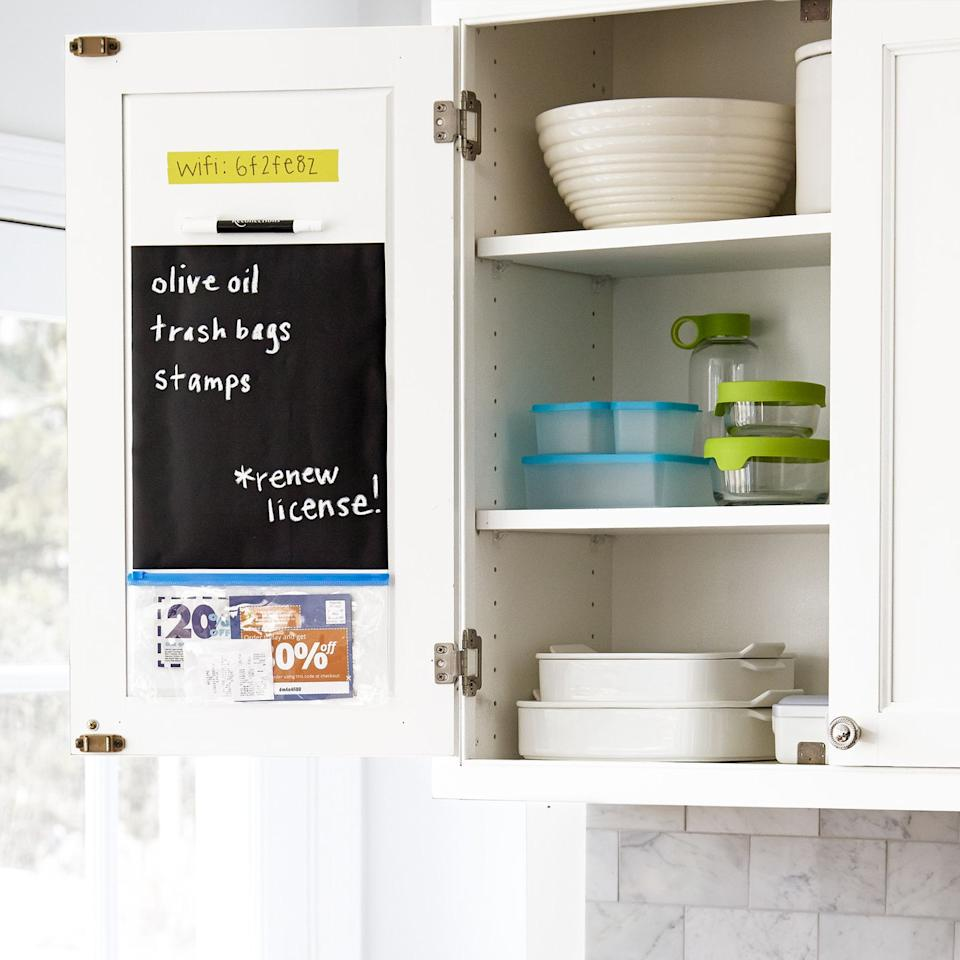 """<p>Turn a blank cabinet door into a command center by adding a stick-on chalkboard decal for reminders and grocery lists, and a plastic pouch to store coupons and receipts. </p><p><strong>RELATED: </strong><a href=""""https://www.goodhousekeeping.com/home/organizing/tips/g1397/small-kitchen-storage/"""" target=""""_blank"""">Smart Storage Ideas for a Small Kitchen </a></p>"""