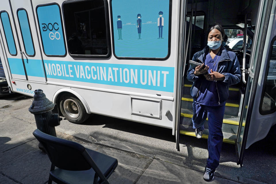 FILE — In this March 29, 2021, file photo, a health care worker steps out of a mobile vaccination van parked on a street corner in the Sunset Park neighborhood of Brooklyn, in New York. New York City hopes to begin offering coronavirus inoculations to tourists by stationing vaccination vans in Times Square and other visitor-heavy spots, Mayor Bill de Blasio said Thursday, May 6, 2021. (AP Photo/Kathy Willens, File)