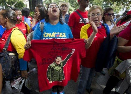 """Supporters of Venezuela's President Hugo Chavez rally in Caracas on December 9, 2012. Chavez admitted a relapse of his cancer late Saturday and designated vice president Nicolas Maduro as his heir apparent in case """"something happened"""" to him. AFP PHOTO/JUAN BARRETO (AFP 