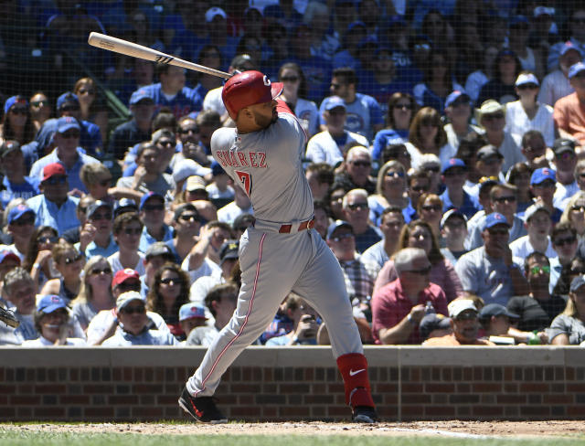 Cincinnati Reds' Eugenio Suarez (7) hits a three-run home run against the Chicago Cubs during the third inning of a baseball game Saturday, July 7, 2018, in Chicago. (AP Photo/David Banks)