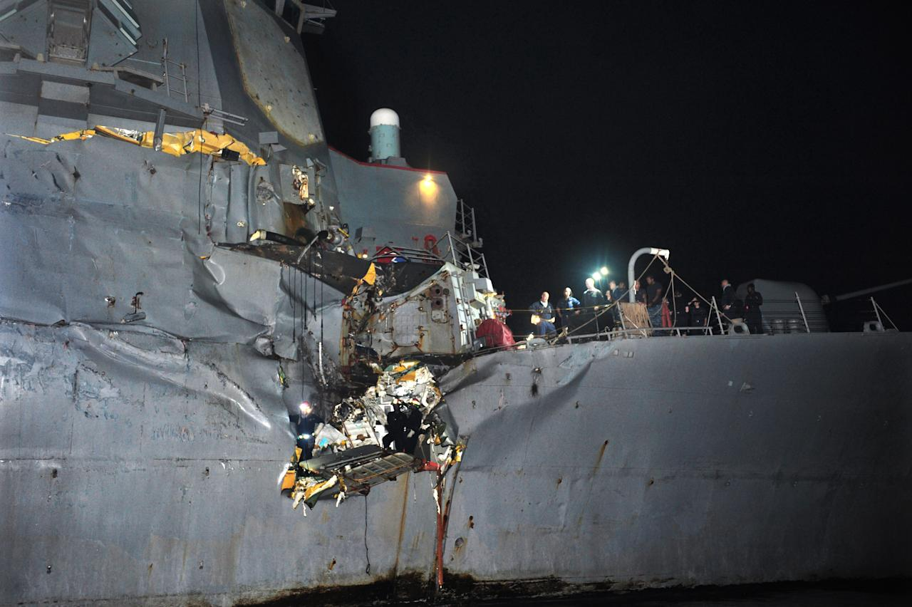 In this image released by the U.S. Navy, the U.S. Navy's guided-missile destroyer is seen damaged after it collided with a Japanese-owned oil tanker just outside the strategic Strait of Hormuz, Sunday, Aug. 12, 2012. The collision left a gaping hole in the starboard side of USS Porter but no one was injured on either vessel, the U.S. Navy said in a statement. (AP Photo/U.S. Navy, Jonathan Sunderman)