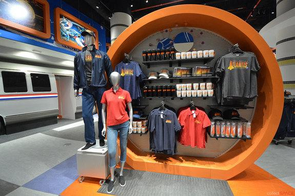 """""""Space Shuttle Atlantis"""" shirts, jackets, caps and mugs, among other souvenirs, are offered in the new """"Shuttle Express"""" shop at NASA's Kennedy Space Center Visitor Complex in Florida."""