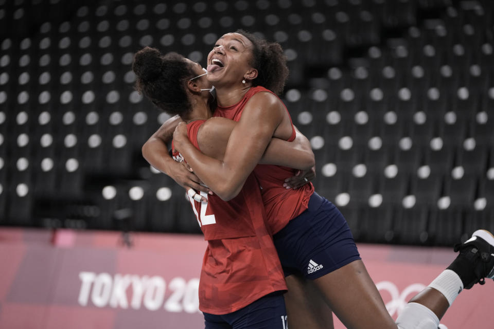 Jordan Thompson, left, and Haleigh Washington, of the United States, embrace after their 3-2 victory over Turkey, at the end of a women's volleyball preliminary round pool B match, at the 2020 Summer Olympics, early Friday, July 30, 2021, in Tokyo, Japan. (AP Photo/Manu Fernandez)