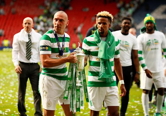 Soccer Football - Scottish Cup Final - Celtic vs Motherwell - Hampden Park, Glasgow, Britain - May 19, 2018 Celtic's Scott Brown and Scott Sinclair celebrate with the trophy after winning the Scottish Cup Action Images via Reuters/Jason Cairnduff