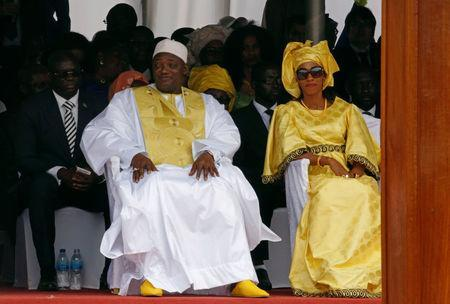 Gambia's new President Adama Barrow is seen with his wife during his swearing-in ceremony at the Independence Stadium, in Bakau, Gambia February 18, 2017. REUTERS/Thierry Gouegnon