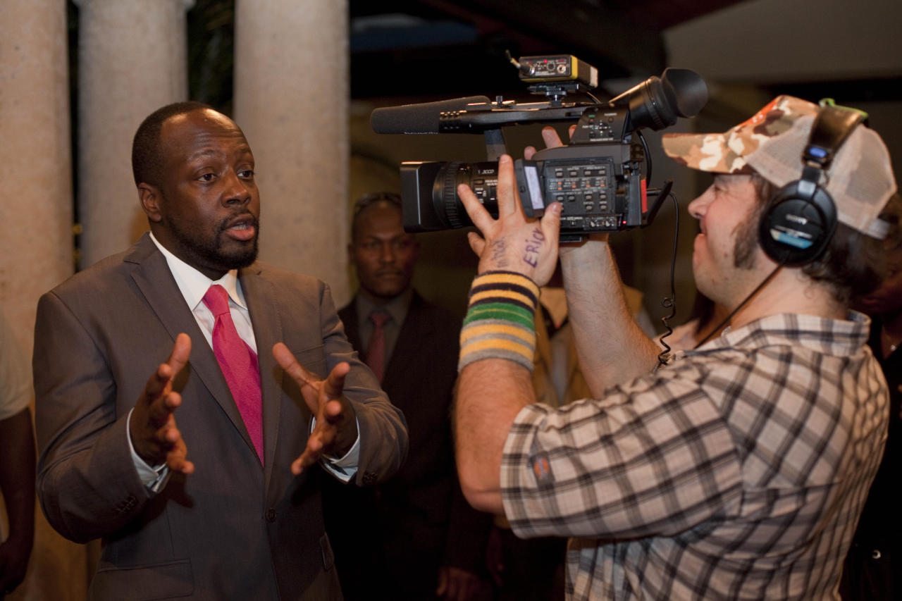 Haitian-born singer Wyclef Jean talks with a videojournalist after a press conference announcing his support on Haiti's presidential candidate Michel Martelly's run for the presidency in Port-au-Prince, Haiti, Wednesday, Feb. 16, 2011.