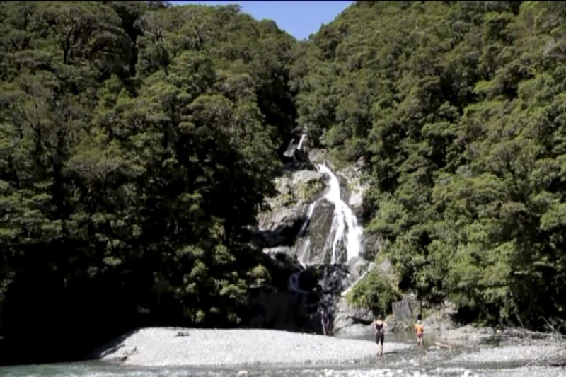 This Tuesday, Feb. 11, 2020, image made from video shows a waterfall at Mount Aspiring National Park, New Zealand. Searchers found the body of British hiker Stephanie Simpson on Friday, Feb. 14, 2020, almost a week after she went hiking in the national park. (Newshub via AP)