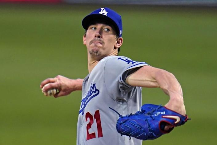 Los Angeles Dodgers starting pitcher Walker Buehler winds up during the third inning of the team's baseball game against the Pittsburgh Pirates in Pittsburgh, Tuesday, June 8, 2021. (AP Photo/Gene J. Puskar)