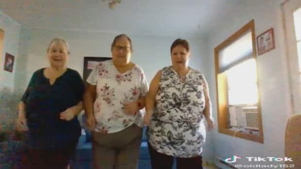 From left: Sisters Wendy Dreger, Lois Kreutzer and Donna Emes had gained millions of views on TikTok for a video of them dancing to the 1962 hit song The Loco-motion. (TikTok/@oldlady152 - image credit)