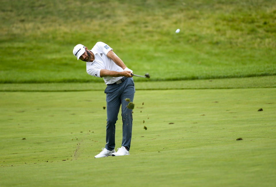 Dustin Johnson hits onto the green on the first hole during the first round of the 3M Open golf tournament in Blaine, Minn., Thursday, July 22, 2021. (AP Photo/Craig Lassig)