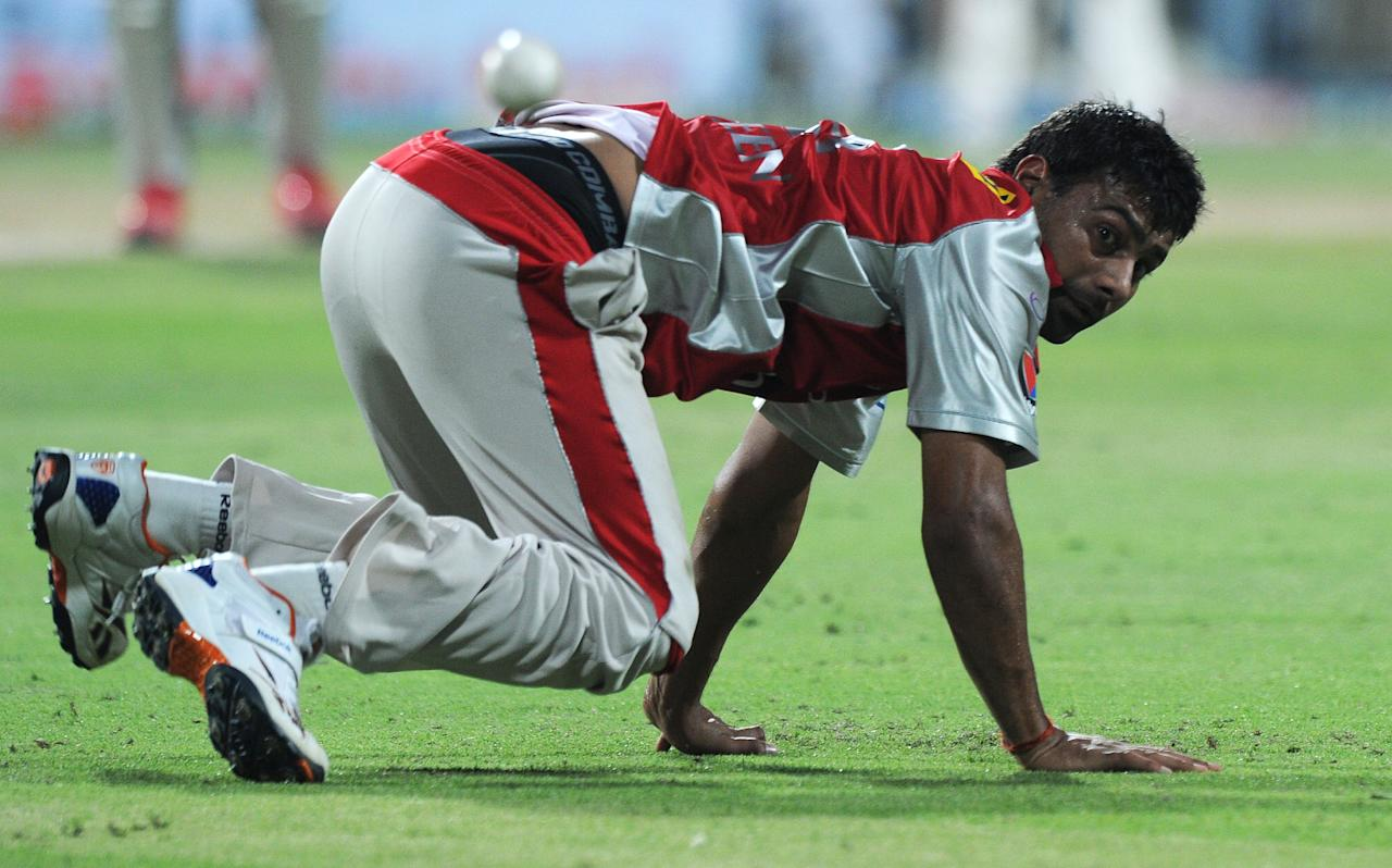 Kings XI Punjab cricketer Praveen Kumar looks on after an unsuccessful fielding attempt during the IPL Twenty20 cricket match between Kolkata Knight Riders and Kings XI Punjab at The Eden Gardens in Kolkata on April 15, 2012. RESTRICTED TO EDITORIAL USE. MOBILE USE WITHIN NEWS PACKAGE. AFP PHOTO/Dibyangshu SARKAR (Photo credit should read DIBYANGSHU SARKAR/AFP/Getty Images)
