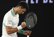 Serbia's Novak Djokovic reacts after winning a point against Russia's Daniil Medvedev during the men's singles final at the Australian Open tennis championship in Melbourne, Australia, Sunday, Feb. 21, 2021.(AP Photo/Andy Brownbill)