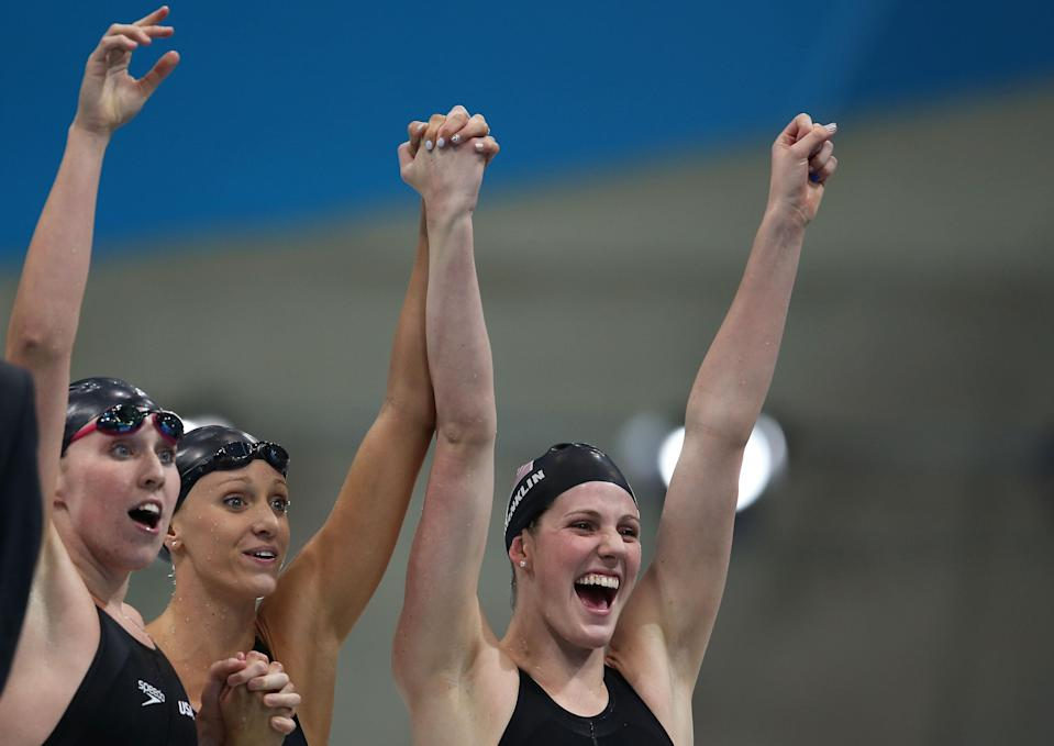 LONDON, ENGLAND - AUGUST 01: Shannon Vreeland, Dana Vollmer and Missy Franklin of the United States celebrate after they won the Final of the Women's 4x200m Freestyle Relay on Day 5 of the London 2012 Olympic Games at the Aquatics Centre on August 1, 2012 in London, England. (Photo by Clive Rose/Getty Images)