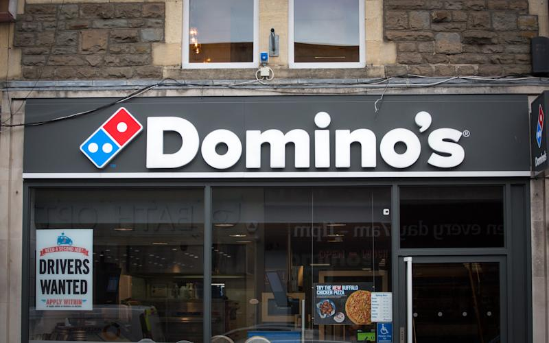 BATH, ENGLAND - FEBRUARY 19: A branch of Domino's pizza takeaway is pictured on February 19, 2018 in Bath, England. The number of takeaway restaurants has increased significantly in the last few years and this has raised concerns that this can lead to over-consumption in cheap, unhealthy high-fat nutrient-poor food and drink leading to higher body weight and greater risk of obesity. (Photo by Matt Cardy/Getty Images)