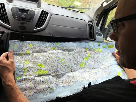 Dr. Humberto Guzman reviews a map of Puerto Rico to find remote villages cut off from medical access in the days since Hurricane Maria in Orocovis, Puerto Rico on October 3, 2017. REUTERS/Robin Respaut
