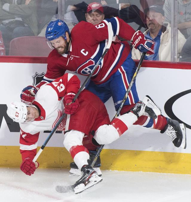 Montreal Canadiens' Shea Weber (6) collides with Detroit Red Wings' Taro Hirose during third-period NHL hockey game action in Montreal, Thursday, Oct. 10, 2019. (Graham Hughes/The Canadian Press via AP)