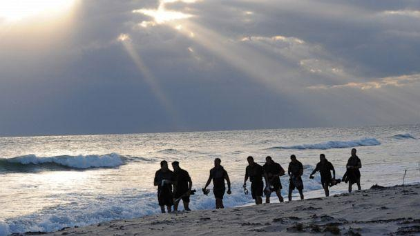 PHOTO: Members of SEAL Team 18 swim into the ocean to release the ashes of fellow SEALs who have died within the last year during a ceremony at Fort Pierce Beach, Fla., Nov. 7, 2010. (Tech. Sgt. Anna-marie Wyant/920th Rescue Wing/Department of Defense)