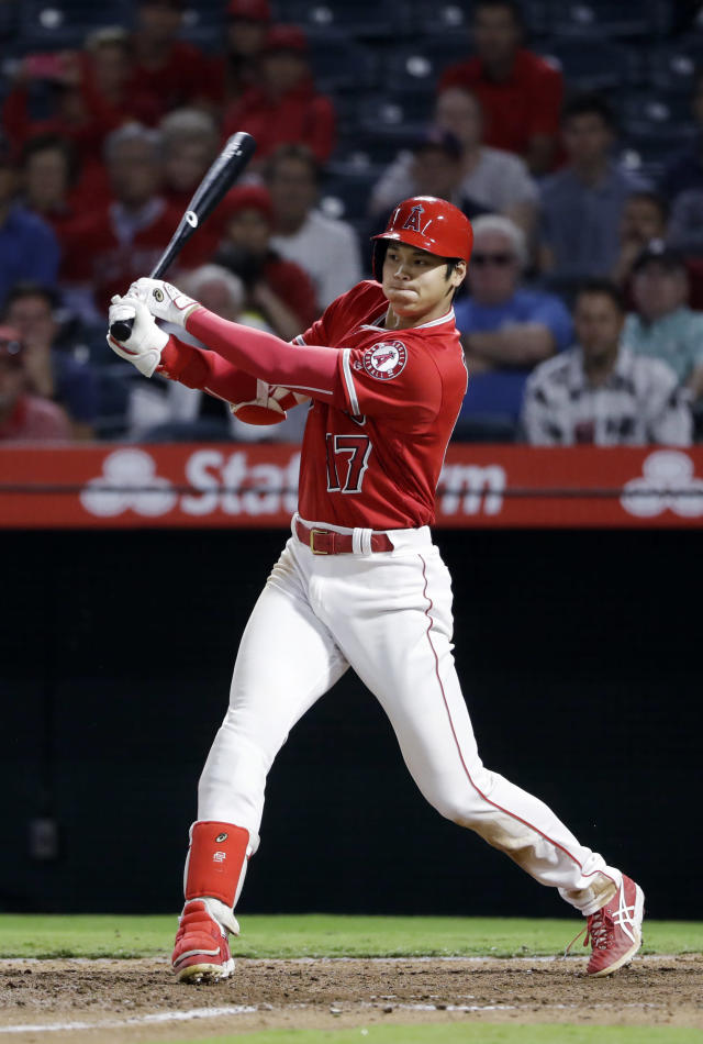 Los Angeles Angels' Shohei Ohtani follows through on an RBI single against the Texas Rangers during the seventh inning of a baseball game, Monday, Sept. 10, 2018, in Anaheim, Calif. (AP Photo/Marcio Jose Sanchez)