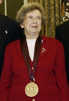 Beverly Cleary wearing a red suit and gold medal