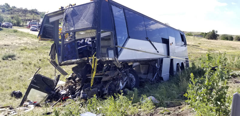 This  Sunday, June 23, 2019 photo, provided by the Colorado State Patrol shows a charter bus involved in a crash along Interstate 25 north of Pueblo, Colo., that killed 2 people and injured at least 13. (Sgt. Blake White/Colorado State Patrol via AP)
