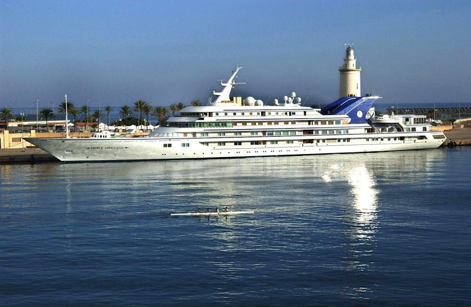 <p>This stunning megayacht is part of the Saudi family's royal fleet of yachts. It was built in 1984 at 482 feet, making it the largest yacht built in the 20th century, and held the spot as world's largest until <em>Dubai</em> was launched in 2006. Its interiors took 15 months alone to craft under the direction of the one-and-only David Hicks, who designed the space to suit 64 guests and 65 crew. The yacht is used for both business and pleasure and is rumored to house missiles and an underwater surveillance system. </p>