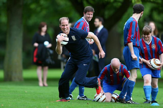 Britain's Prince William trains in the grounds of Buckingham Palace, in central London October 7, 2013. Prince William, as President of the Football Association, hosted a reception and football match between Polytechnic FC and Civil Service FC to celebrate The FA's 150 grassroot heroes. REUTERS/Shaun Botterill/Pool (BRITAIN - Tags: ENTERTAINMENT SOCIETY ROYALS SPORT SOCCER)