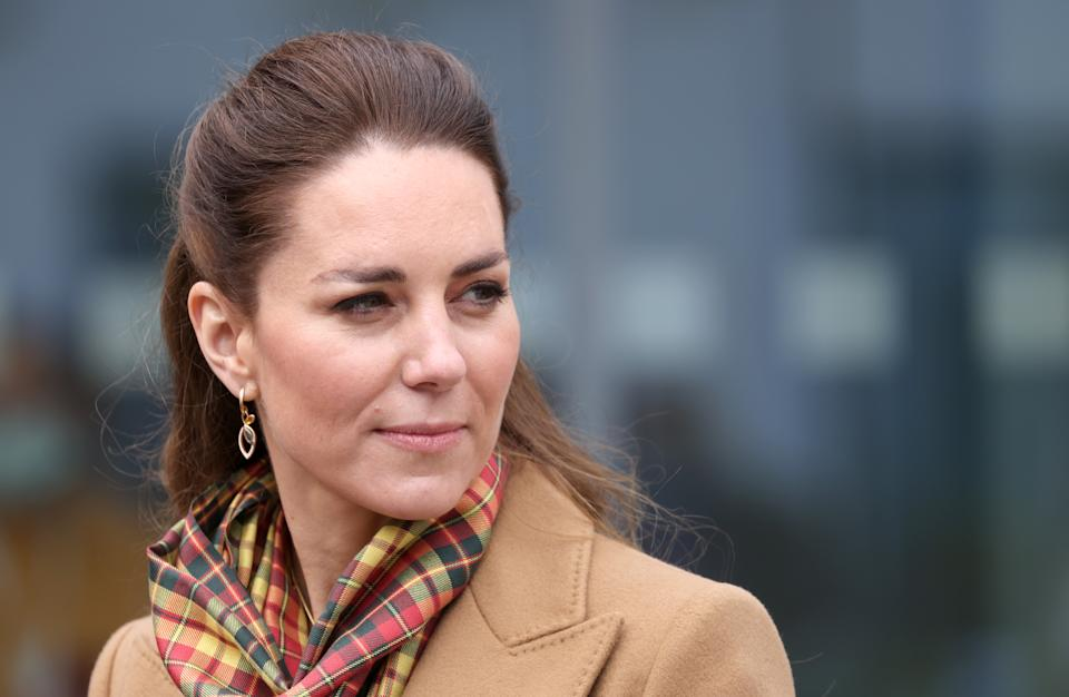 KIRKWALL, SCOTLAND - MAY 25: Catherine, Duchess of Cambridge as she visits to officially open The Balfour, Orkney Hospital with Prince William, Duke of Cambridge on day five of their week long visit to Scotland on May 25, 2021 in Kirkwall, Scotland. Recently opened in 2019, The Balfour replaced the old hospital, which had served the community for ninety years. The new facility has enabled the repatriation of many NHS services from the Scottish mainland, allowing Orkney's population to receive most of their healthcare at home. The new building's circular design is based on the 5000-year-old Neolithic settlement, Skara Brae, making it a unique reflection of the local landscape in which many historical sites are circles. (Photo by Chris Jackson - WPA Pool/Getty Images)
