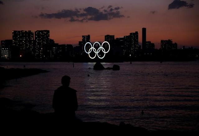 The giant Olympic rings are seen in the dusk at the waterfront area at Odaiba Marine Park in Tokyo