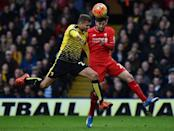 Watford's Almen Abdi (L) goes head to head with Liverpool's Adam Lallana during the match in Watford, on December 20, 2015 (AFP Photo/Ben Stansall)