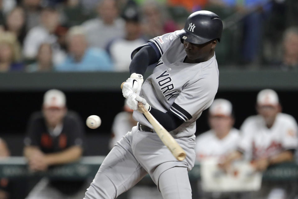 New York Yankees' Didi Gregorius flies out against Baltimore Orioles starting pitcher Asher Wojciechowski during the first inning of a baseball game, Tuesday, Aug. 6, 2019, in Baltimore. (AP Photo/Julio Cortez)