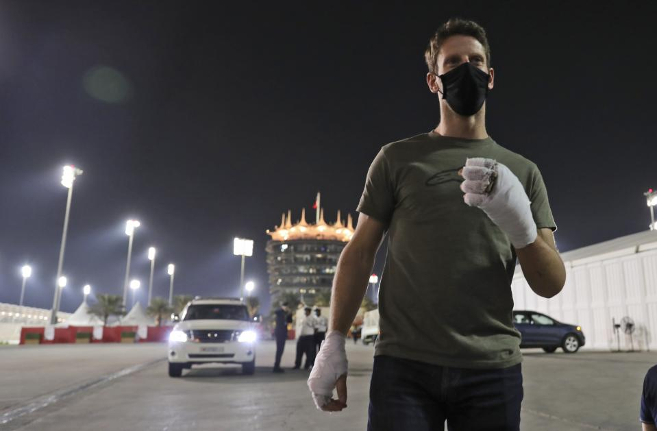 Haas driver Romain Grosjean of France arrives to to thank the marshals Thursday, Dec. 3, 2020, at Bahrain International Circuit in Sakhir, Bahrain.  Grosjean escaped with only minor burns when his Haas car exploded into a fireball after crashing on the first lap at last weekend's Bahrain GP. (AP Photo/Kamran Jebreili)